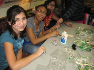 Teens working on a Christmas Ornament craft project