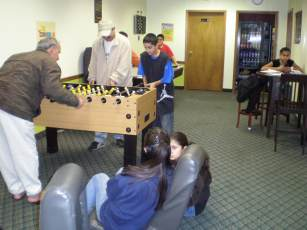 Parents playing games with teens